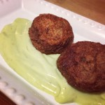 Black bean cakes with avocado cream sauce